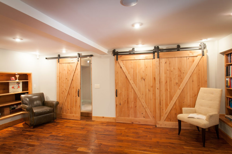 triple barn door wall photography by mark bealer of studio 66 office designs e